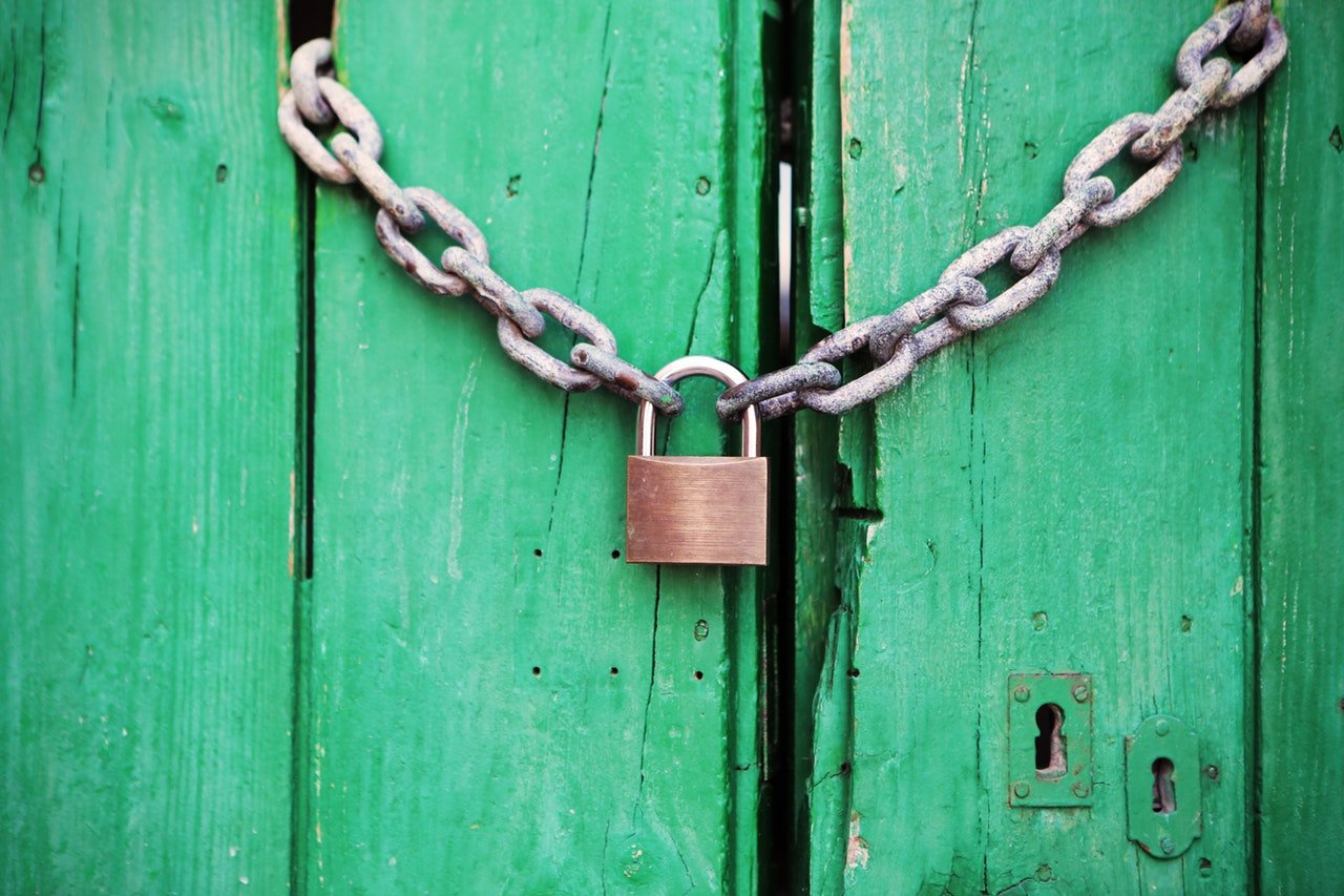 A padlocked door—encourage strong security practices from your users