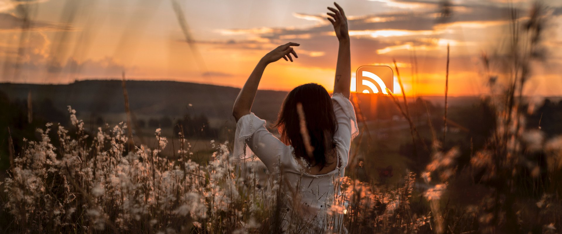 A woman standing in front of a sunrise with the RSS logo.
