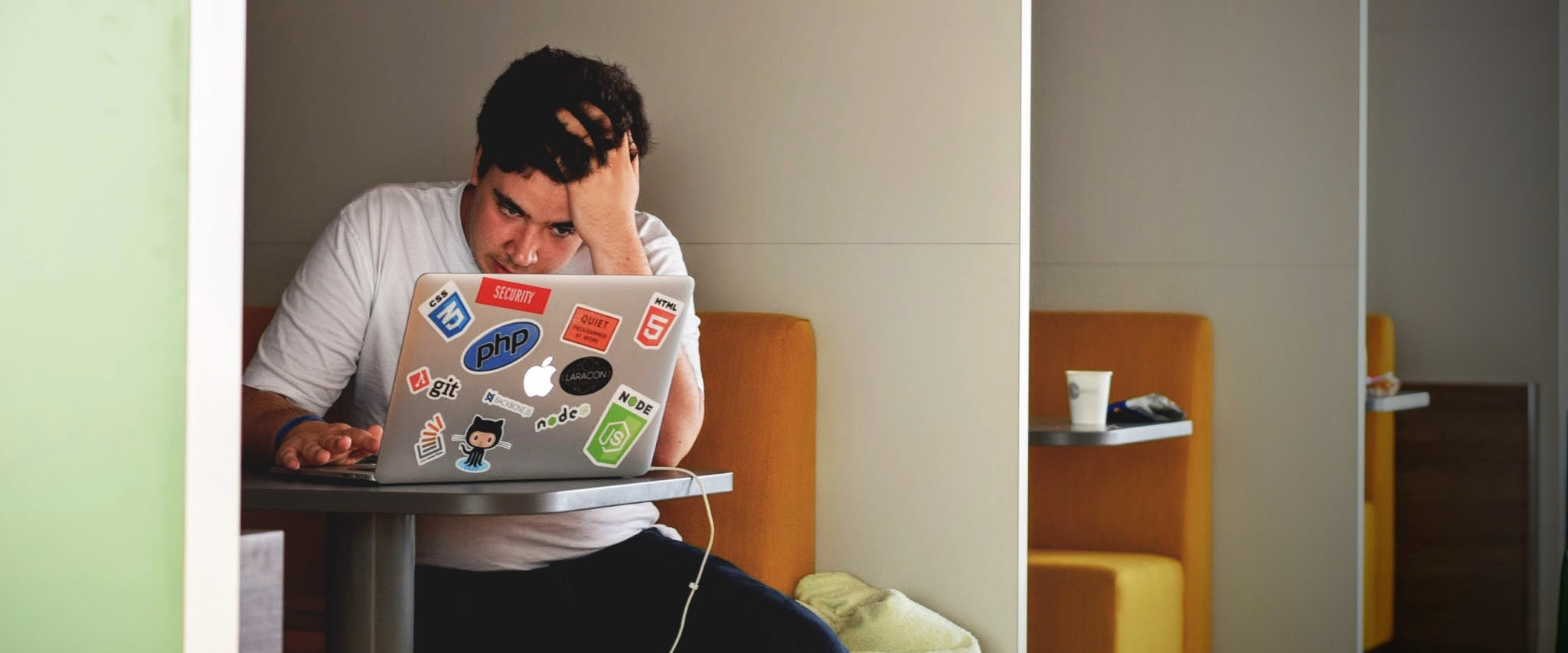 VPS troubleshooting: A man frustrated over his laptop